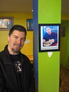 Taco enthusiast Jeff is elated to pose for a PHOTO OPPORTUNITY next to a picture of a previous PHOTO OPPORTUNITY at Chunga's.